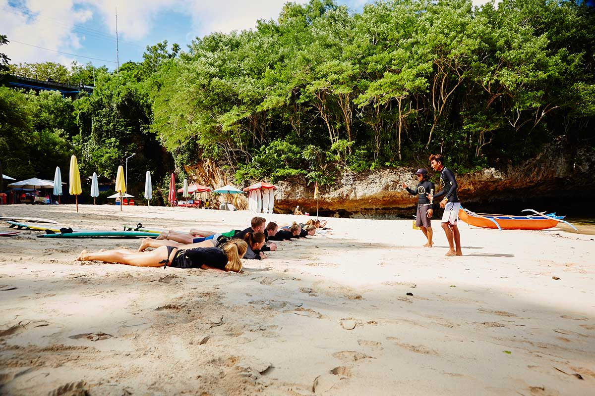 Kamafari Surfcamp Bali | Paddle training at the beach
